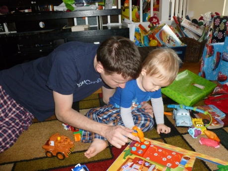 Daddy and Jack playing with a Handy Manny tool book