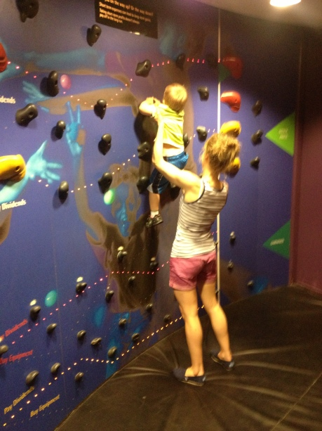 Teaching him to rock climb